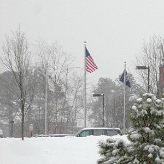 American Flag over snowy hill